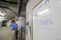 Hammond Stadium worker Paul Francis stands outside the Minnesota Twins' clubhouse after a game between the Twins and the Baltimore Orioles was canceled Thursday, March 12, 2020, in Fort Myers, Fla. Major League Baseball has suspended the rest of its spring training game schedule because of the coronavirus outbreak. MLB is also delaying the start of its regular season by at least two weeks. (AP Photo/Elise Amendola)