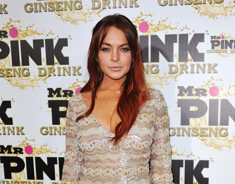 FILE - In this Oct. 11, 2012 file photo, Lindsay Lohan attends the Mr. Pink Ginseng launch party at the Beverly Wilshire hotel in Beverly Hills, Calif.  Lohan's attorney wrote in a letter filed in court on Feb. 22, 2013, that the  actress is willing to record public service announcements and provide inspirational talks at schools and hospitals as a possible way to resolve a case that alleges she lied to police about a car accident. (Photo by Richard Shotwell/Invision/AP, File)
