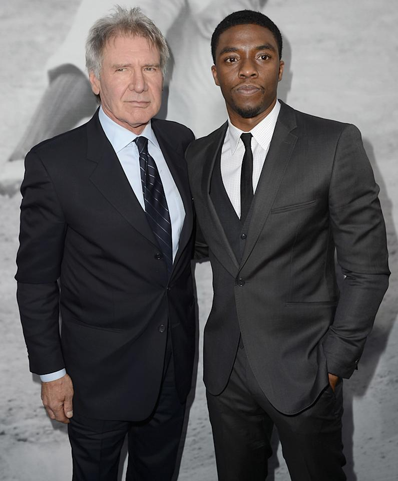 "HOLLYWOOD, CA - APRIL 09:  Actors Harrison Ford and Chadwick Boseman attend the Los Angeles Premiere of Warner Bros. Pictures' and Legendary Pictures' ""42"" at TCL Chinese Theatre on April 9, 2013 in Hollywood, California.  (Photo by Kevin Winter/Getty Images)"