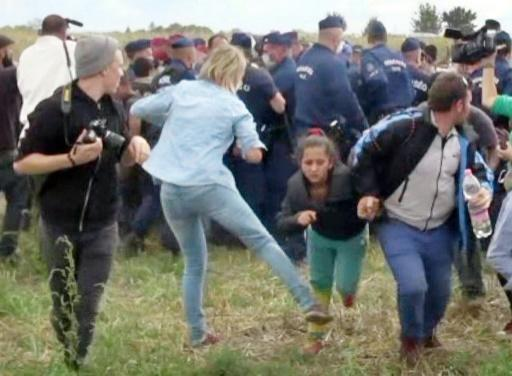 Hungarian camerawoman 'regrets' kicking refugees