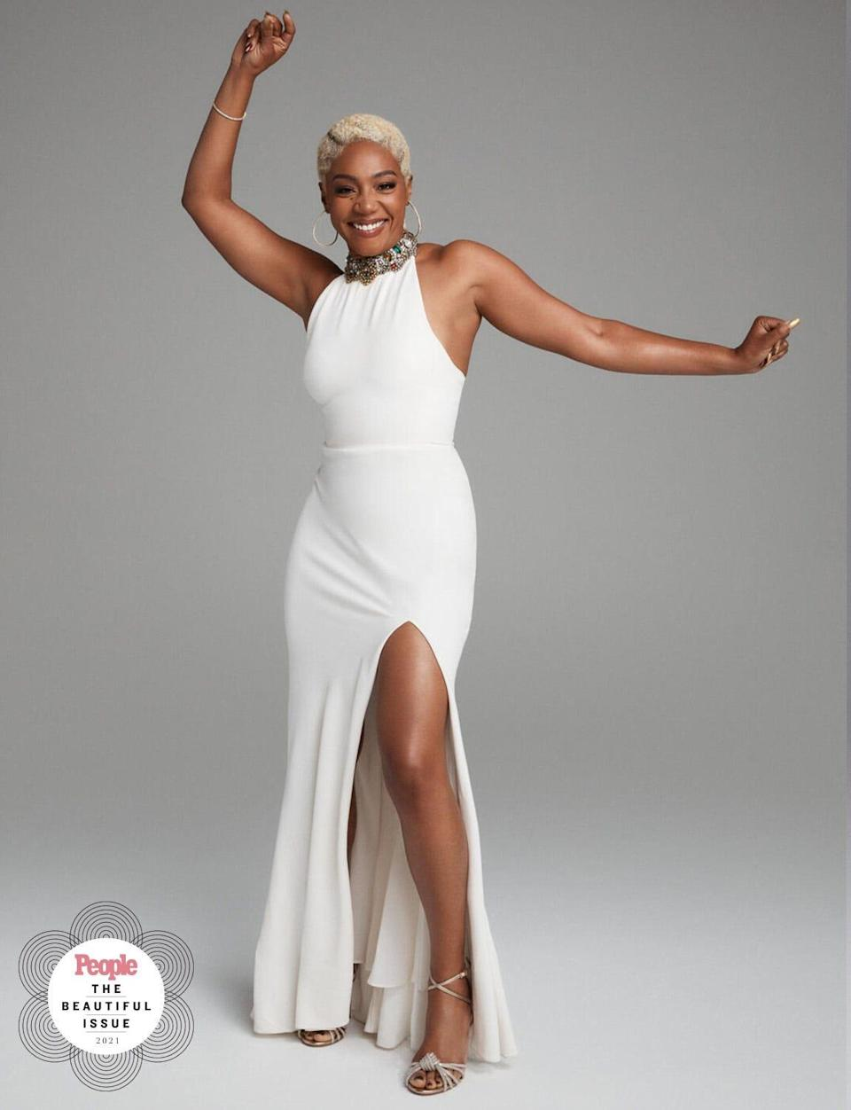"""Tiffany Haddish has re-worn her white Alexander McQueen gown, which she debuted at the 2017 premiere of her movie """"Girls Trip,"""" five times, most recently for People's 2021 Beautiful issue."""