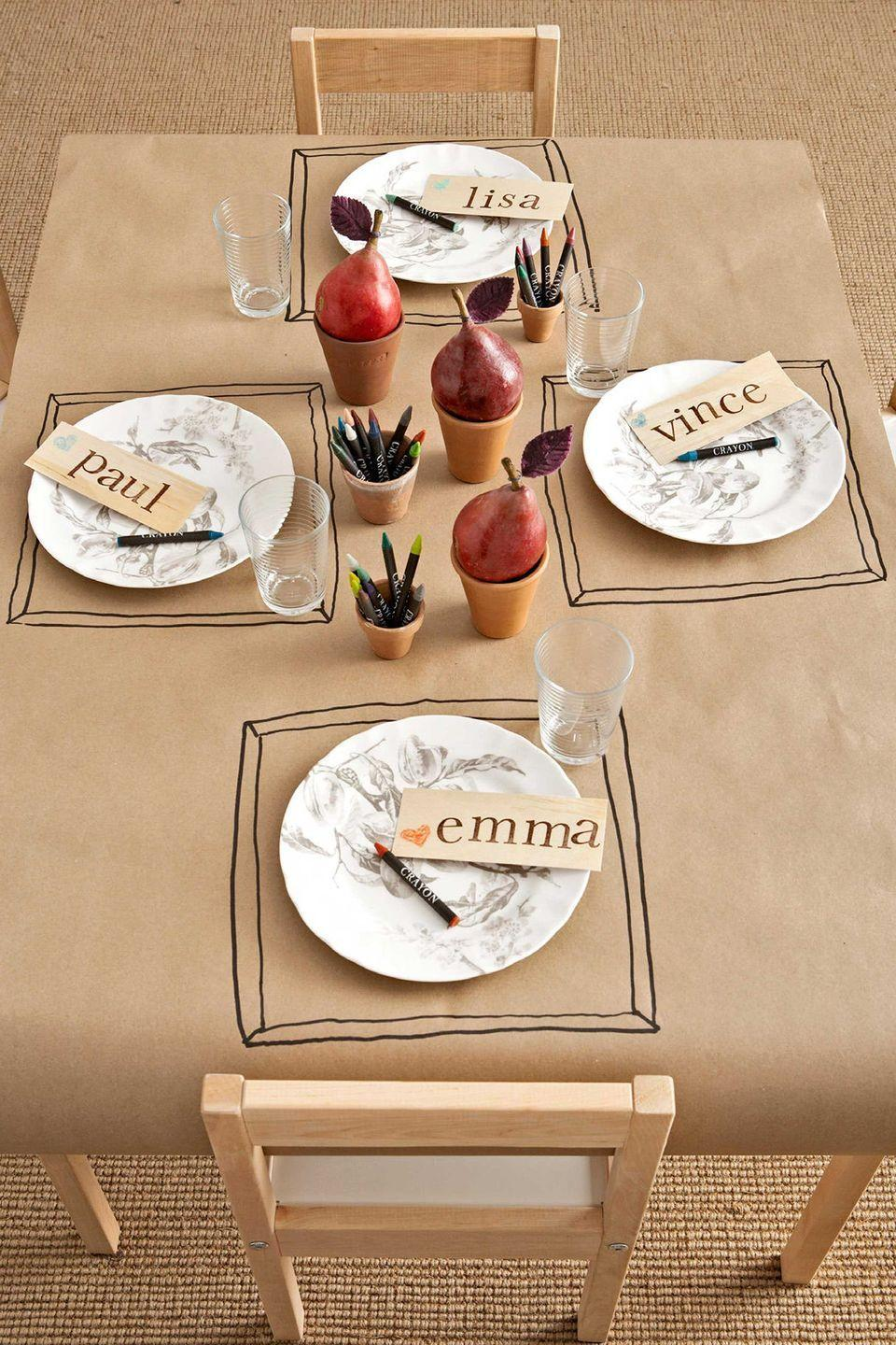 """<p>A roll of kraft paper makes a fun tablecloth for the kids' table—make sure to set out terra-cotta pots filled with crayons (and pears, for decoration). </p><p><a class=""""link rapid-noclick-resp"""" href=""""https://www.amazon.com/Kraft-Paper-Roll-150ft-Brown/dp/B01N6584SD/?tag=syn-yahoo-20&ascsubtag=%5Bartid%7C10050.g.1371%5Bsrc%7Cyahoo-us"""" rel=""""nofollow noopener"""" target=""""_blank"""" data-ylk=""""slk:SHOP KRAFT PAPER"""">SHOP KRAFT PAPER</a><br></p>"""