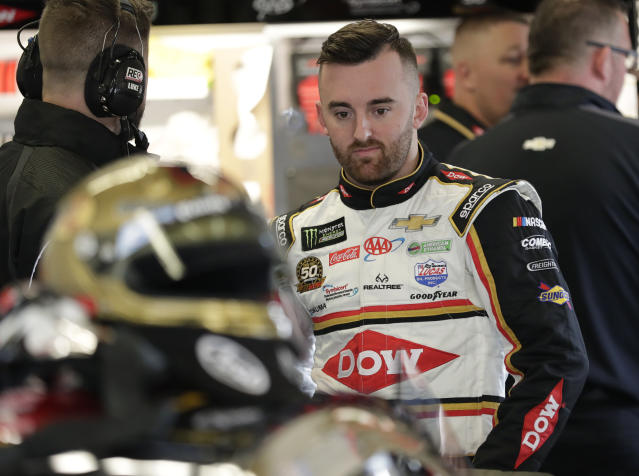 Austin Dillon prepares to get in his car during NASCAR auto race practice at Daytona International Speedway, Saturday, Feb. 9, 2019, in Daytona Beach, Fla. (AP Photo/John Raoux)