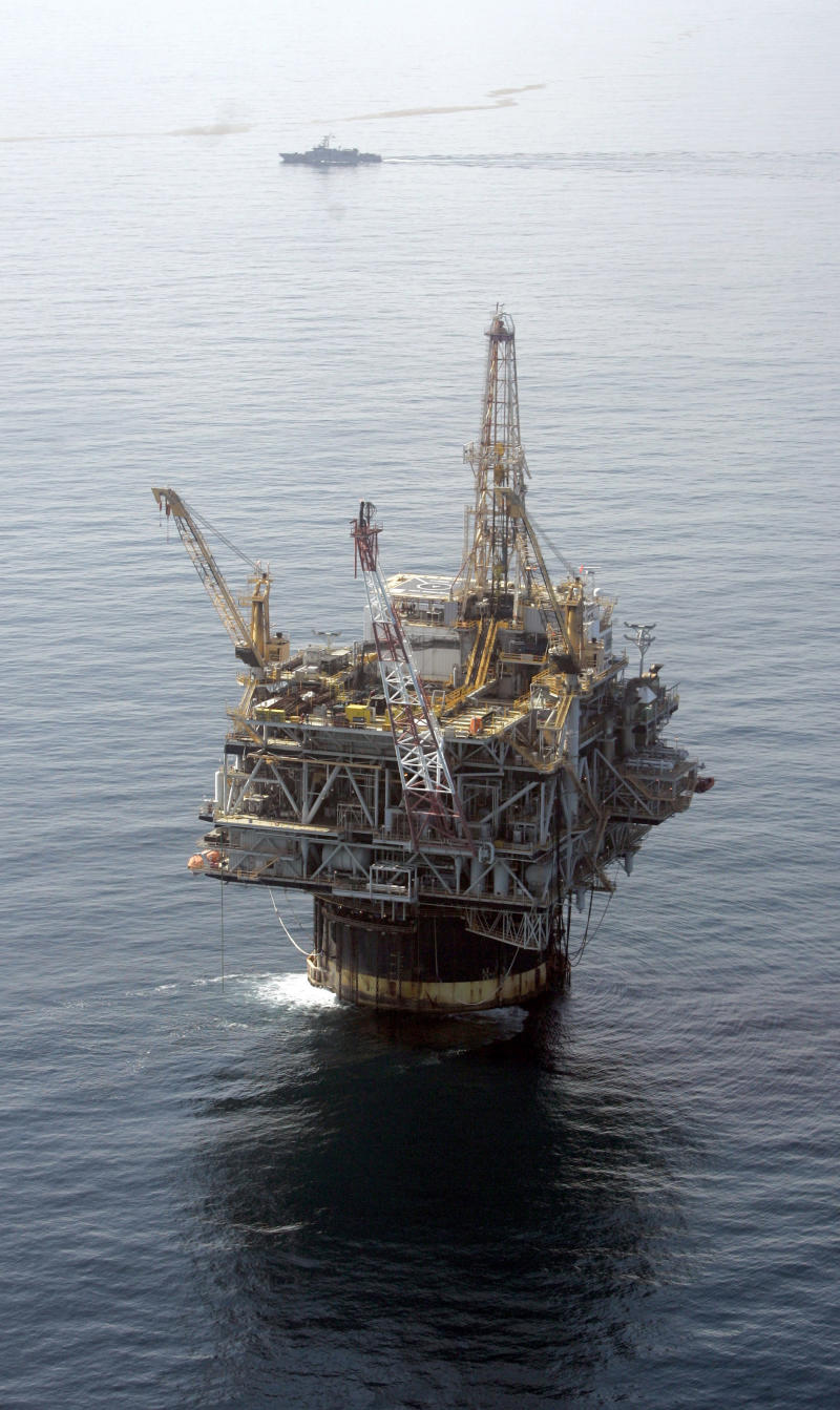 FILE - In this Aug. 19, 2008 file photo, the Chevron Genesis Oil Rig Platform in the Gulf of Mexico near New Orleans, La. Chevron Corp. said Friday, Oct. 29, 2010, income slipped nearly 2 percent in the third quarter on costs related to the Gulf of Mexico drilling moratorium and hefty foreign exchange charges. (AP Photo/Mary Altaffer, file)
