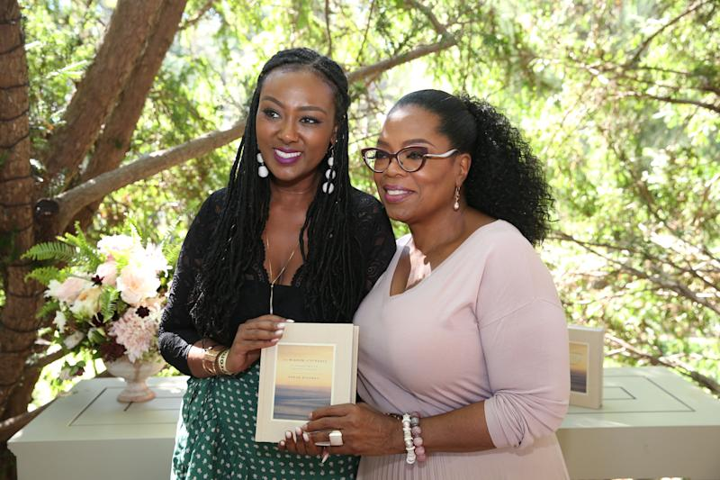 "I stand beside Oprah as we pose with her latest book, ""The Wisdom of Sundays."" (Harpo Inc/George Burns)"