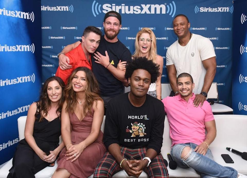 Members of the <em>Arrow</em> cast at this year's San Diego Comic-Con. Front row, from left: Beth Schwartz, Juliana Harkavy, Echo Kellum, and Rick Gonzalez. Back row, from left: Colton Haynes, Stephen Amell, Emily Bett Rickards, David Ramsey. (Photo: Vivien Killilea/Getty Images for SiriusXM)