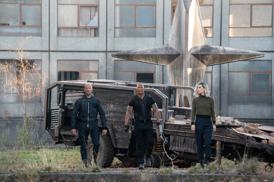 Luke Hobbs (Dwayne Johnson), Deckard Shaw (Jason Statham), and Hattie Shaw (Vanessa Kirby) team up and face off in Fast & Furious Presents: Hobbs & Shaw, directed by David Leitch. (Credit: Universal)
