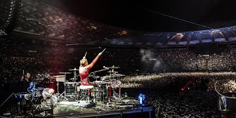 """This photo released by MUSE shows Muse in their 4K Ultra High Definition concert film, """"Muse - Live at Rome Olympic Stadium, """" in July 2013. Following advance screenings, the film will be released in over 700 cinemas in 40 countries for limited screenings from Nov. 6, 2013. (AP Photo/MUSE, Hans-Peter van Velthoven)"""