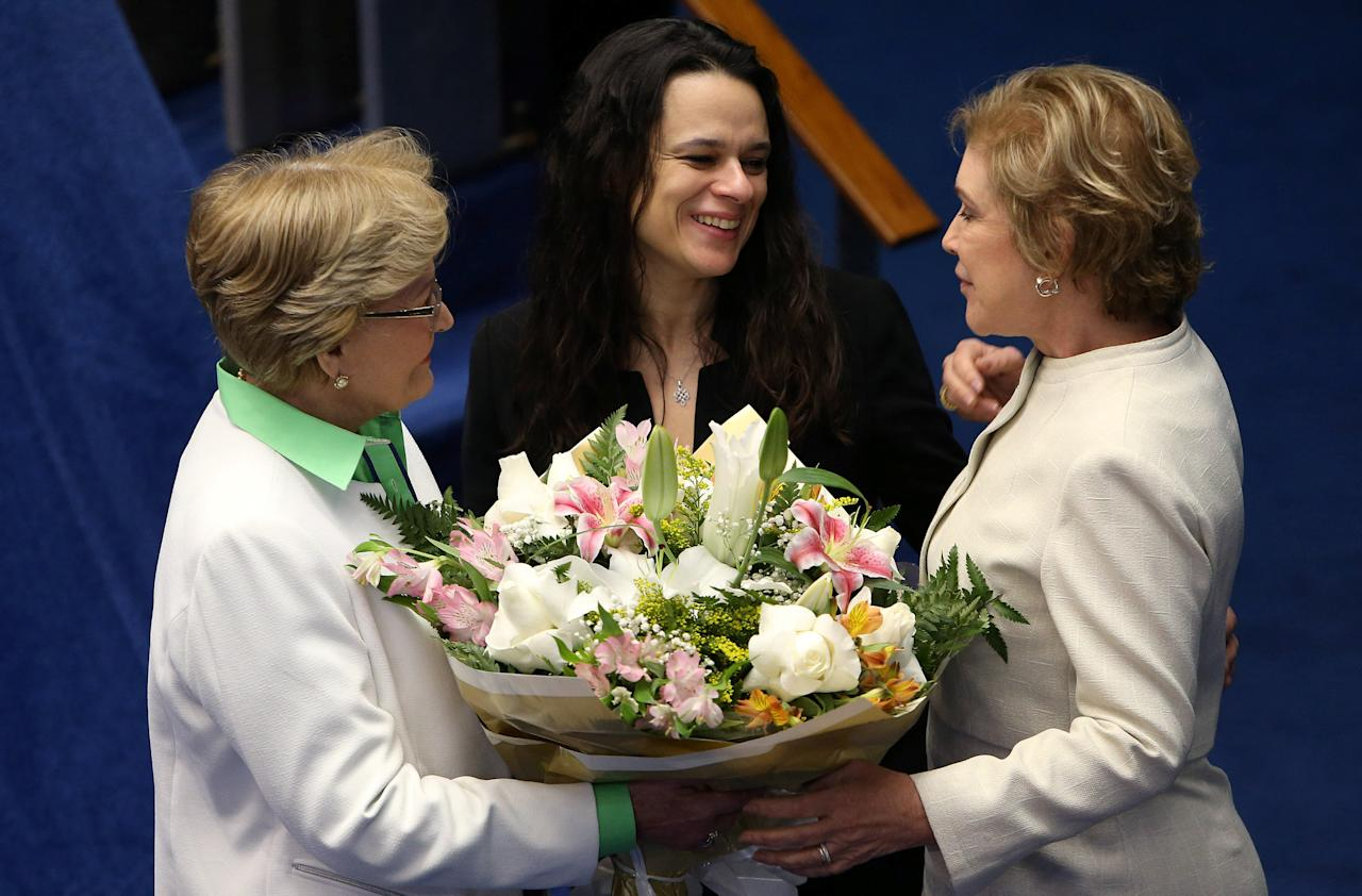 Brazilian jurist Janaina Paschoal (C), co-author of the complaint that originated the impeachment process against suspended president Dilma Rousseff, receives flowers from senators Ana Amelia (L) and Marta Suplicy during a final session of debate and voting on Rousseff's impeachment trial in Brasilia, Brazil, August 30, 2016. REUTERS/Adriano Machado
