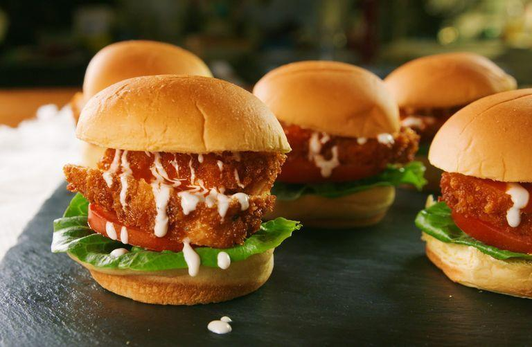 """<p>There are two ways you can eat this mouthwatering chicken glazed with zesty buffalo sauce: in a delicious slider, or cut and tossed with a tasty dip. </p><p><em><a href=""""https://www.goodhousekeeping.com/food-recipes/a30381345/buffalo-glazed-chicken-two-ways-recipe/"""" rel=""""nofollow noopener"""" target=""""_blank"""" data-ylk=""""slk:Get the recipe for Buffalo Glazed Chicken »"""" class=""""link rapid-noclick-resp"""">Get the recipe for Buffalo Glazed Chicken »</a></em></p>"""