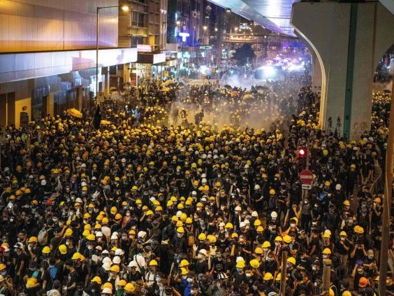 Police fire tear gas on protesters to disperse them after the march (LAUREL CHOR/AFP/Getty Images)