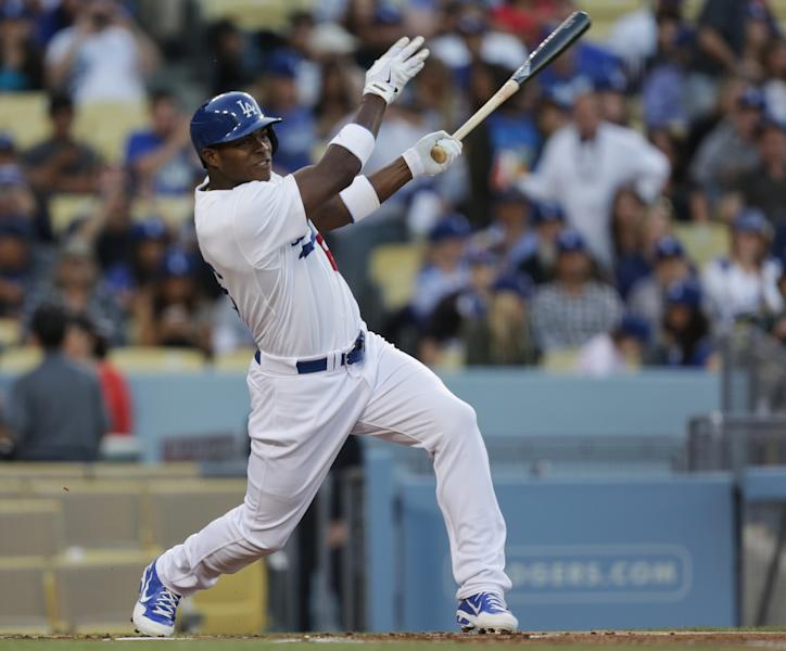 Los Angeles Dodgers' Yasiel Puig follows through for a double during the first inning of their baseball game against the San Diego Padres, Tuesday, June 4, 2013, in Los Angeles. (AP Photo/Jason Redmond)