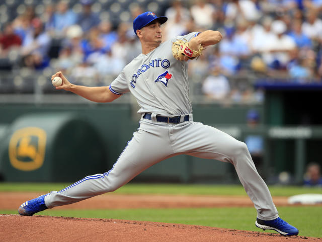Toronto Blue Jays starting pitcher Jacob Waguespack delivers to a Kansas City Royals batter during the first inning of a baseball game at Kauffman Stadium in Kansas City, Mo., Wednesday, July 31, 2019. (AP Photo/Orlin Wagner)