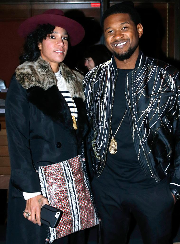 Usher and his wife, Grace Miguel, during Paris Fashion Week on January 18.