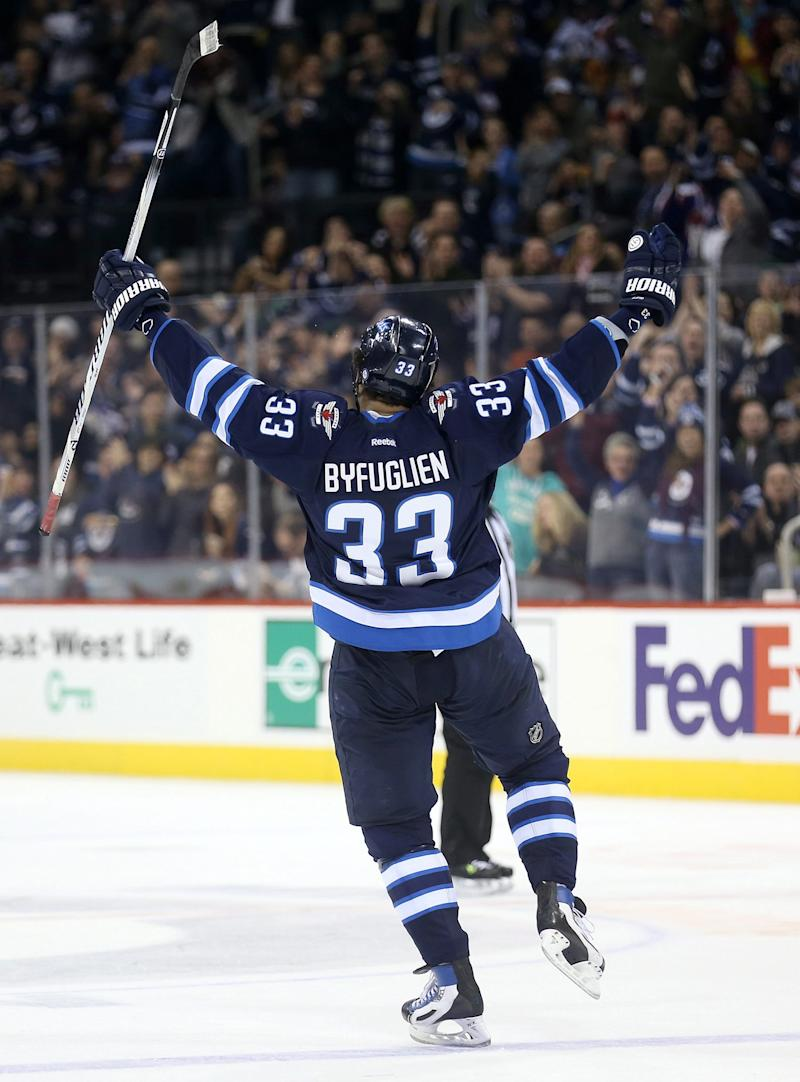 Byfuglien helps Jets soar past Stars 7-2