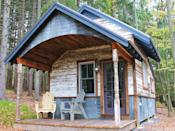 """<p>One of 14 tiny cabins at the <a href=""""https://bluemoonrising.org/"""" rel=""""nofollow noopener"""" target=""""_blank"""" data-ylk=""""slk:Blue Moon Rising ecotourism retreat"""" class=""""link rapid-noclick-resp"""">Blue Moon Rising ecotourism retreat</a> in McHenry, Maryland, the 250-square foot Kaya has a rustic reclaimed metal and wood exterior. Built by the folks at <a href=""""http://www.hobbitatspaces.com"""" rel=""""nofollow noopener"""" target=""""_blank"""" data-ylk=""""slk:Hobbitat"""" class=""""link rapid-noclick-resp"""">Hobbitat</a>, the quaint interior features a living space, queen-bed nook, bathroom, and kitchen with a view of nature, all under a curved, corrugated metal ceiling. Rental rates per night range from $249 to $349.<br></p><p><a class=""""link rapid-noclick-resp"""" href=""""https://go.redirectingat.com?id=74968X1596630&url=https%3A%2F%2Fwww.tripadvisor.com%2FHotel_Review-g41261-d5535285-Reviews-Blue_Moon_Rising-McHenry_Garrett_County_Maryland.html&sref=https%3A%2F%2Fwww.oprahdaily.com%2Flife%2Fg35047961%2Ftiny-house%2F"""" rel=""""nofollow noopener"""" target=""""_blank"""" data-ylk=""""slk:PLAN YOUR TRIP"""">PLAN YOUR TRIP</a> <a class=""""link rapid-noclick-resp"""" href=""""https://bluemoonrising.org/cabin-rentals/kaya/"""" rel=""""nofollow noopener"""" target=""""_blank"""" data-ylk=""""slk:SEE INSIDE"""">SEE INSIDE</a></p>"""