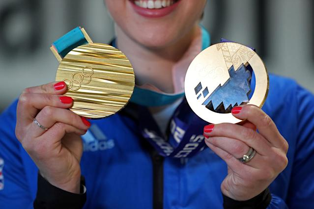 Winter Olympics - Team GB Homecoming - Heathrow Airport, London, Britain - February 26, 2018 Lizzy Yarnold of Britain poses with her gold medals from the Pyeongchang and Sochi Winter Olympics Action Images via Reuters/Peter Cziborra