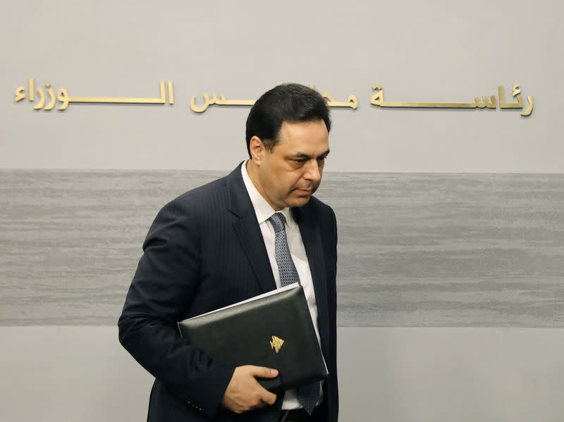 Lebanon's Prime Minister Hassan Diab leaves after speaking during a televised address to the the nation, at the governmental palace in Beirut