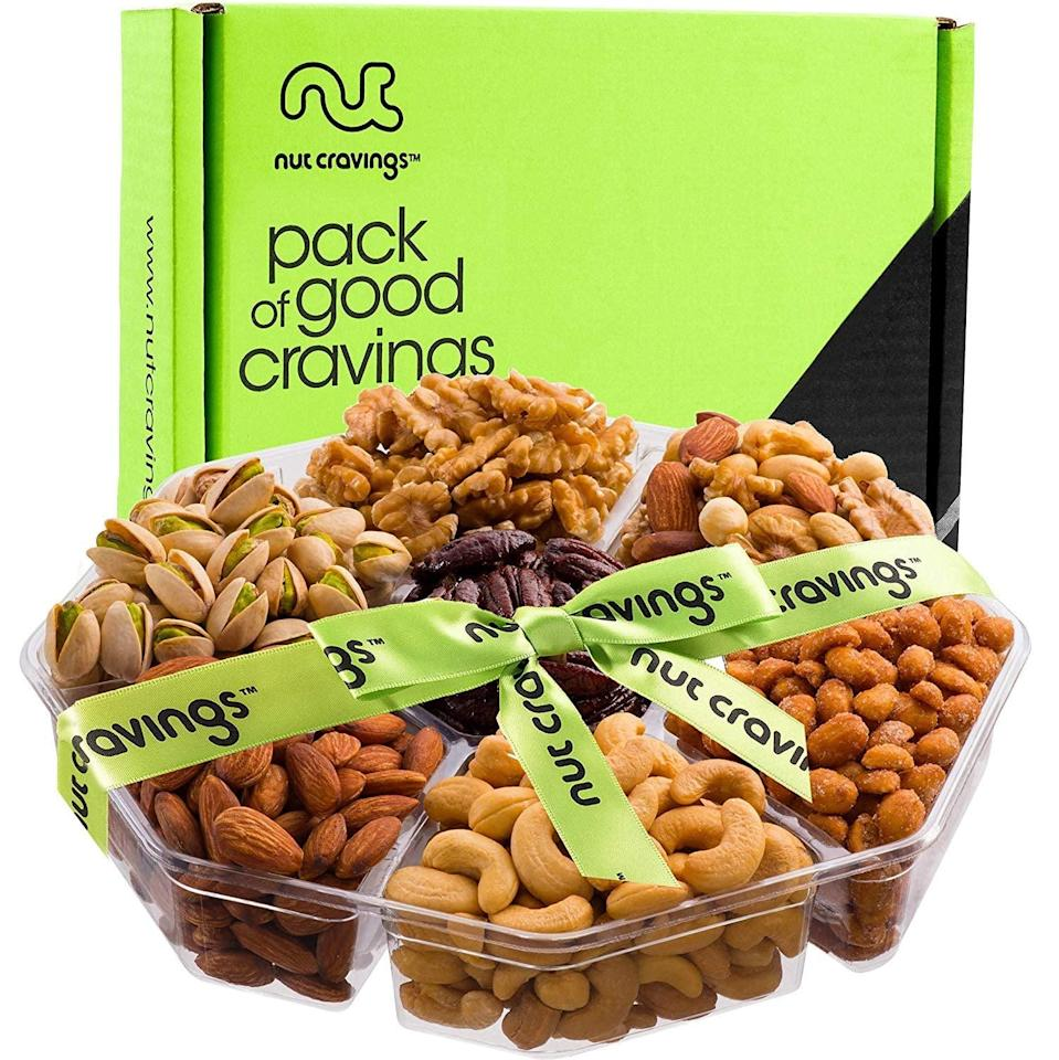 <p>Take a break from all the sweets with this <span>Holiday Nuts Gift Basket</span> ($28).</p>