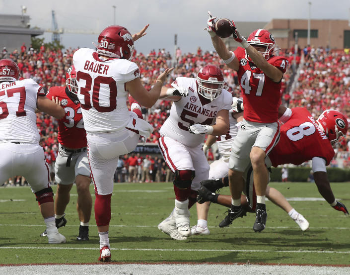 Georgia defensive back Dan Jackson blocks the punt in the endzone by Arkansas kicker Reid Bauer and Georgia recovered for the touchdown during the first quarter of an NCAA college football game on Saturday, Oct. 2, 2021, in Athens. (Curtis Compton/Atlanta Journal-Constitution via AP)
