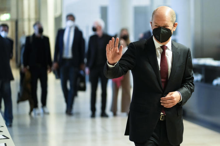 German Finance Minister Olaf Scholz and Social Democratic Party candidate for chancellor arrives for the first faction meeting of the party's lawmaker at the parliament Bundestag in Berlin, Tuesday, Sept. 28, 2021. Germany's newly elected lawmakers are holding their first meetings as their parties digest the fallout of Sunday's election that reduced outgoing Chancellor Angela Merkel's bloc to its worst-ever result and start the process of putting together a new government. (AP Photo/Markus Schreiber)