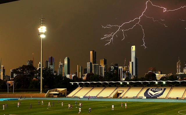 <p>A general view as lightning strikes near buildings in the city of Melbourne during the round eight W-League match between the Melbourne Victory and Western Sydney Wanderers at Lakeside Stadium on November 24, 2017 in Melbourne, Australia. (Photo by Scott Barbour/Getty Images) </p>