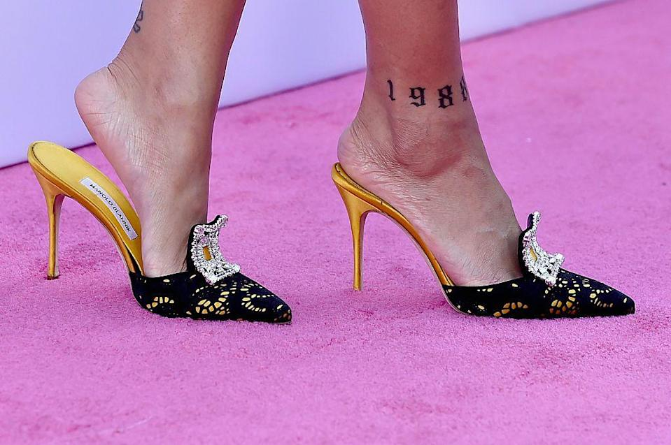 <p>Rihanna also has the year 1988 inked in block lettering on the front of her right foot, which happens to be the year the Grammy winning singer was born. </p>