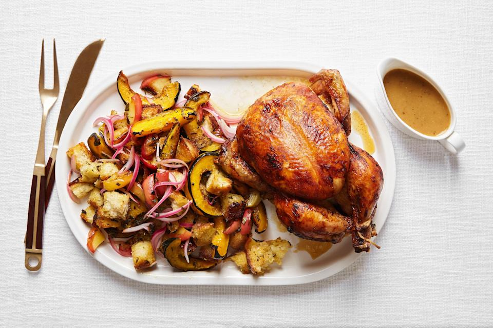 """This Thanksgiving chicken comes with a crispy, craggy bread and squash salad which has all the buttery, herby flavor of classic stuffing. It's ideal for small groups (or anyone who doesn't love turkey). <a href=""""https://www.epicurious.com/recipes/food/views/miso-butter-roast-chicken-acorn-squash-panzanella?mbid=synd_yahoo_rss"""" rel=""""nofollow noopener"""" target=""""_blank"""" data-ylk=""""slk:See recipe."""" class=""""link rapid-noclick-resp"""">See recipe.</a>"""
