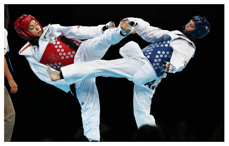 <p>Women who compete in Taekwondo wear a dobok underneath another protective layer. Headgear makes sure fighters are extra safe.</p><p><i>(Photo: Getty Images)</i><br></p>