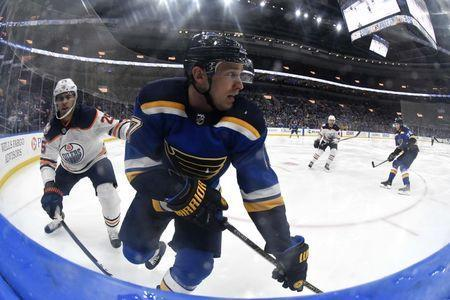 Mar 19, 2019; St. Louis, MO, USA; St. Louis Blues left wing Jaden Schwartz (17) skates with the puck as Edmonton Oilers defenseman Darnell Nurse (25) defends during the third period at Enterprise Center. Mandatory Credit: Jeff Curry-USA TODAY Sports