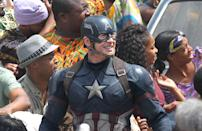 Chris Evans and company stare at something off-camera. The unknown menace will presumably be added via CGI.
