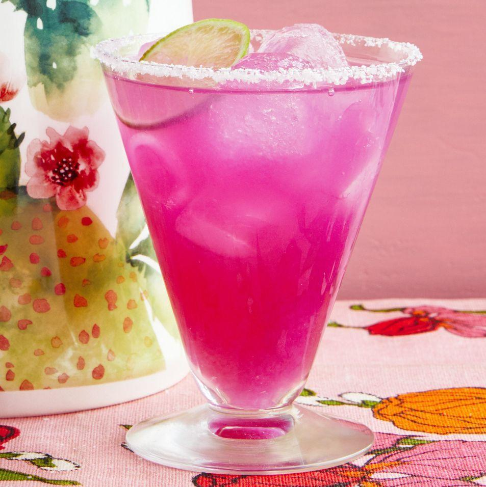 """<p>These super-fun margaritas use a naturally magenta-colored syrup made from prickly pear cactus juice. You can find the syrup <a href=""""https://www.amazon.com/Prickly-Pear-Cactus-Syrup-Southwest/dp/B000GGOEBE/ref=sr_1_5?tag=syn-yahoo-20&ascsubtag=%5Bartid%7C2164.g.36432840%5Bsrc%7Cyahoo-us"""" rel=""""nofollow noopener"""" target=""""_blank"""" data-ylk=""""slk:here"""" class=""""link rapid-noclick-resp"""">here</a>!</p><p><a href=""""https://www.thepioneerwoman.com/food-cooking/recipes/a35948993/prickly-pear-margaritas-recipe/"""" rel=""""nofollow noopener"""" target=""""_blank"""" data-ylk=""""slk:Get the recipe."""" class=""""link rapid-noclick-resp""""><strong>Get the recipe. </strong></a></p><p><a class=""""link rapid-noclick-resp"""" href=""""https://go.redirectingat.com?id=74968X1596630&url=https%3A%2F%2Fwww.walmart.com%2Fsearch%2F%3Fquery%3Dmargarita%2Bglasses&sref=https%3A%2F%2Fwww.thepioneerwoman.com%2Ffood-cooking%2Fmeals-menus%2Fg36432840%2Ffourth-of-july-drinks%2F"""" rel=""""nofollow noopener"""" target=""""_blank"""" data-ylk=""""slk:SHOP MARGARITA GLASSES"""">SHOP MARGARITA GLASSES</a></p>"""