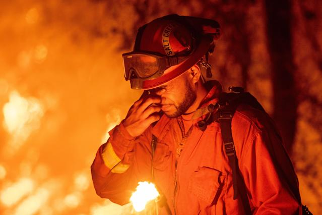 <p>An inmate firefighter pauses during a firing operation as the Carr fire continues to burn in Redding, Calif. on July 27, 2018. (Photo: Josh Edelson/AFP/Getty Images) </p>