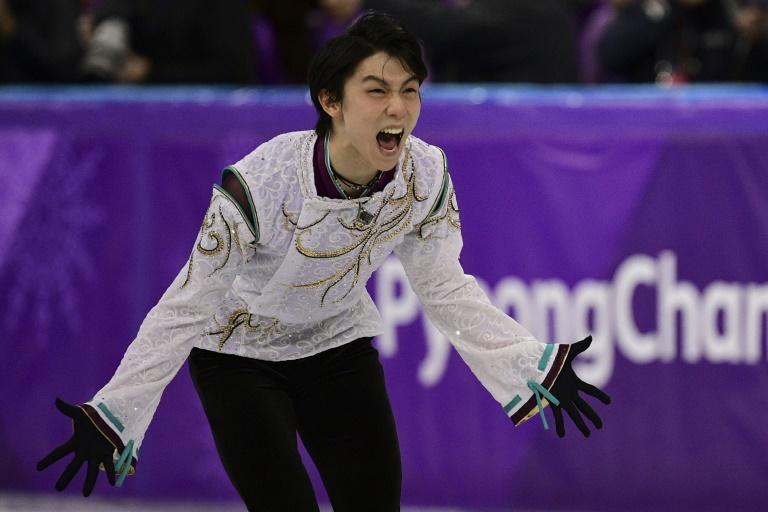 Japan's Yuzuru Hanyu, winner of the men's single skating gold medal, tells a press conference Sunday he has set his sights on mastering the quadruple axel