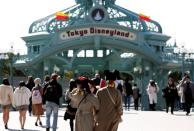 Visitors are seen outside Tokyo Disneyland in Urayasu