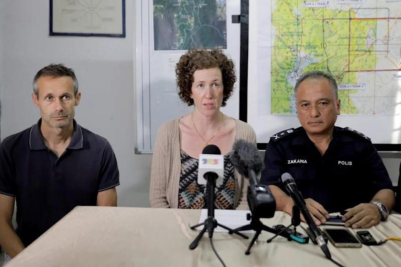 Nora's mother, Meabh Quoirin (centre) with her husband, Sebastian Quoirin (left) at the Pantai police station making the announcement. — Bernama pic