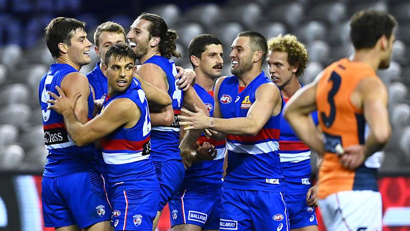 Pictured here, the Western Bulldogs celebrate during their win over GWS.