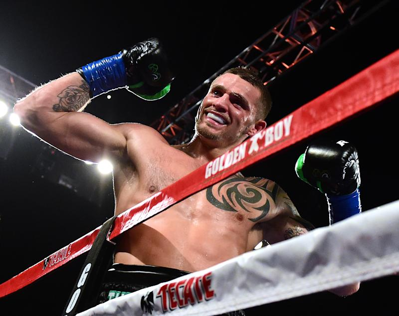 INGLEWOOD, CA - DECEMBER 17: Joe Smith Jr. reacts after punching Bernard Hopkins out of the ring for a ninth round TKO to win the WBC International Light Heavyweight title at The Forum on December 17, 2016 in Inglewood, California. (Photo by Harry How/Getty Images)