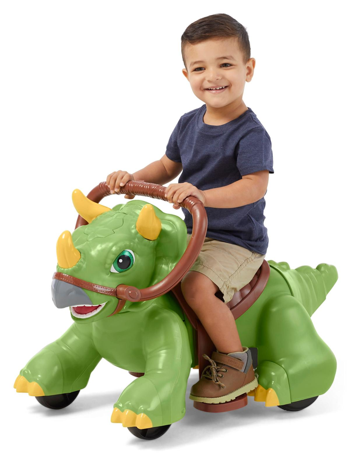 "Get ready for tons of prehistoric fun with the Rideamals Dinosaur by Kid Trax! This tot-sized triceratops features multiple types of interactive play: feed, pet, walk, and ride. Watch your child&rsquo;s eyes light up as their new friend responds to them &ndash; including 20 unique sounds. A (plastic) fern and grapes are included for &ldquo;feeding&rdquo; the dinosaur.&nbsp; <strong><a href=""https://fave.co/2PFLRLp"" rel=""nofollow noopener"" target=""_blank"" data-ylk=""slk:Find it for $79 at Walmart"" class=""link rapid-noclick-resp"">Find it for $79 at Walmart</a>.</strong>"