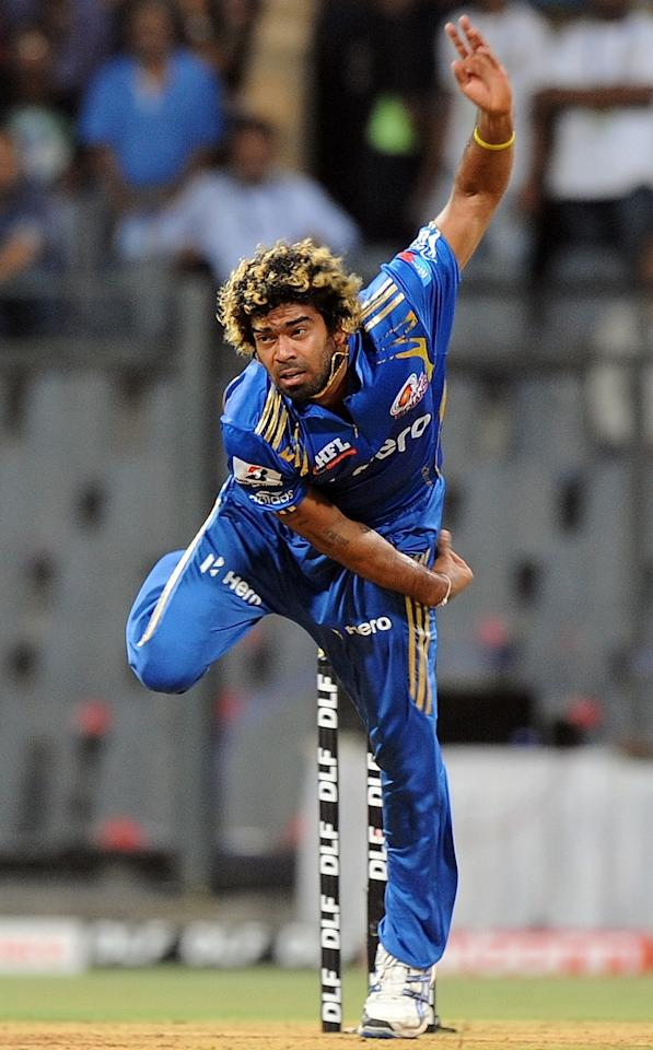 Mumbai Indians cricketer Lasith Malinga bowls during the IPL Twenty20 cricket match between Mumbai Indians and Deccan Chargers at the Wankhede Stadium in Mumbai on April 29, 2012.  RESTRICTED TO EDITORIAL USE. MOBILE USE WITHIN NEWS PACKAGE.  AFP PHOTO/Punit PARANJPE        (Photo credit should read PUNIT PARANJPE/AFP/GettyImages)