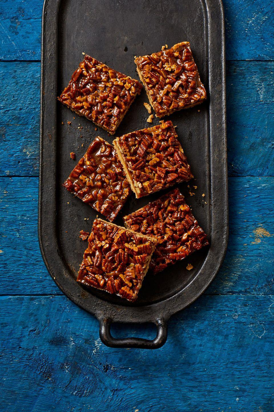 """<p>Bourbon, brown sugar and rich caramel make the perfect on-the-go treat this fall.</p><p><em><a href=""""https://www.goodhousekeeping.com/food-recipes/dessert/a33809115/pecan-pie-bar-recipe/"""" rel=""""nofollow noopener"""" target=""""_blank"""" data-ylk=""""slk:Get the recipe for Pecan Pie Bars »"""" class=""""link rapid-noclick-resp"""">Get the recipe for Pecan Pie Bars »</a></em></p><p><strong>RELATED: </strong><a href=""""https://www.goodhousekeeping.com/food-recipes/dessert/g28089407/easy-fall-desserts/"""" rel=""""nofollow noopener"""" target=""""_blank"""" data-ylk=""""slk:60 Easy Fall Desserts That'll Wow Your Dinner Guests"""" class=""""link rapid-noclick-resp"""">60 Easy Fall Desserts That'll Wow Your Dinner Guests</a></p>"""