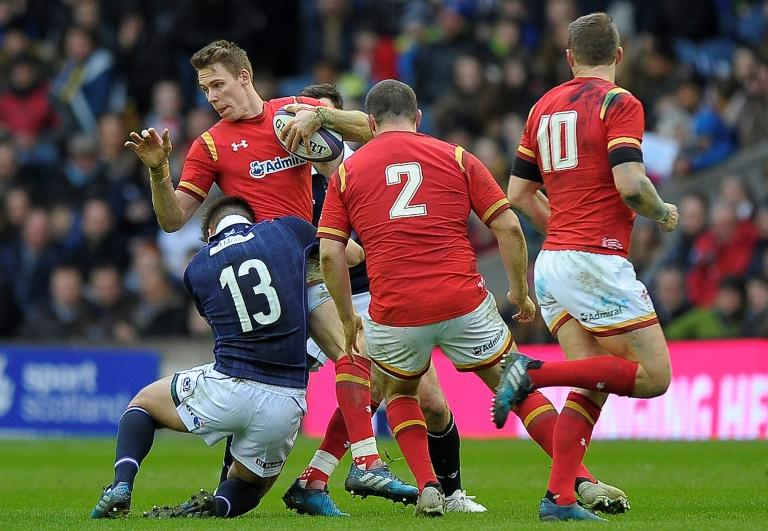 Scotland centre Huw Jones (L) tackles Wales' wing Liam Williams during their Six Nations match at Murrayfield, in Edinburgh, on Febuary 25, 2017