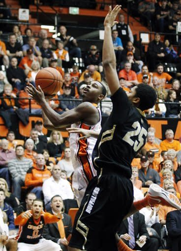 Oregon State's Ahmad Starks (3) shoots a layup as Colorado's Spencer Dinwiddie (25) defends in the second half of an NCAA college basketball game, Saturday, March 3, 2012, in Corvallis, Ore. (AP Photo/Rick Bowmer)