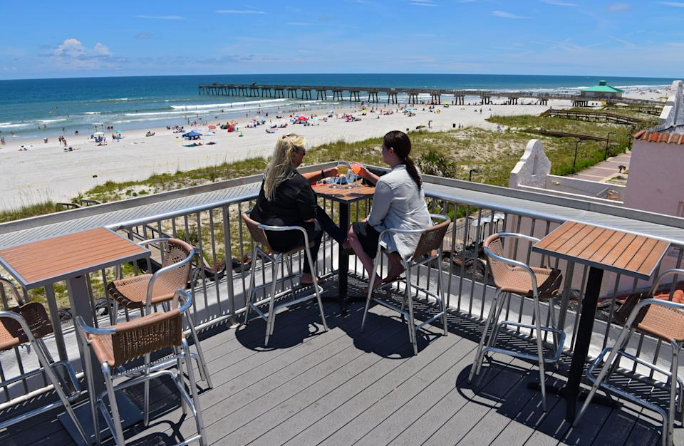 Casa Marina Hotel & Restaurant's rooftop lounge offers spectacular views of the Jacksonville Beach Pier and the Atlantic Ocean.