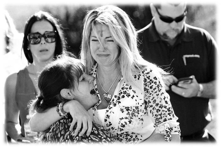 Parents after the shooting at Marjory Stoneman Douglas High School in Parkland, Fla., Feb. 14, 2018. (Photo: Joel Auerbach/AP, digitally enhanced by Yahoo News)
