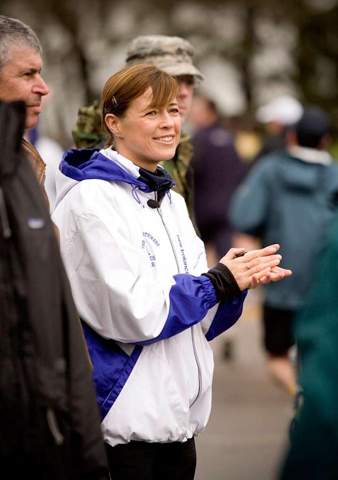 Three time Boston Marathon winner, Uta Pippig, cheering on the NOVA runners at the Boston Marathon.
