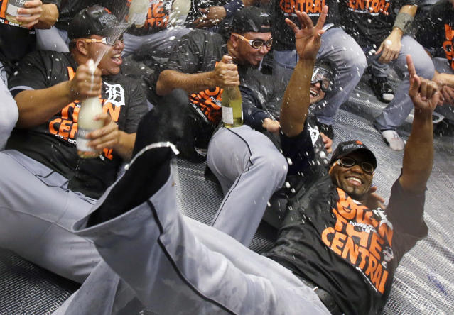 Detroit Tigers pitchers Bruce Rondon, left, Joaquin Benoit, center and Al Alburquerque, right, celebrate after the Tigers won the AL Central title with a 1-0 win over the Minnesota Twins in a baseball game, Wednesday, Sept. 25, 2013, in Minneapolis. (AP Photo/Jim Mone)
