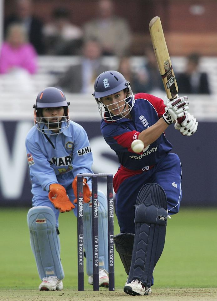 LONDON - AUGUST 14:  Claire Taylor of England hits out on her way to making fifty runs during the first Natwest Womens International match between England and India at Lord's on August 14, 2006 in London, England.  (Photo by Paul Gilham/Getty Images)