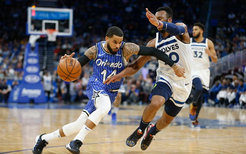 Orlando Magic guard D.J. Augustin drives around Minnesota Timberwolves guard Josh Okogie in Orlando, Feb, 7, 2019.