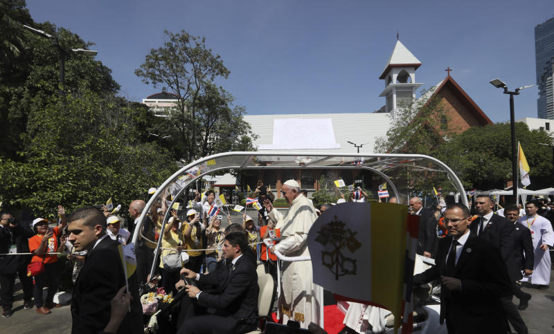 Pope Francis greets the crowd at Saint Louis Hospital in Bangkok, Thailand, Thursday, Nov. 21, 2019. Pope Francis called for migrants to be welcomed and for women and children to be protected from exploitation, abuse and enslavement as he began a busy two days of activities in Thailand on Thursday. (AP Photo/Manish Swarup)